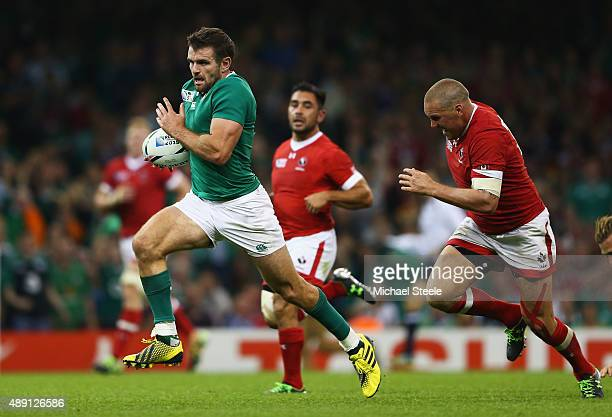 Jared Payne of Ireland breaks through on his way to score a try during the 2015 Rugby World Cup Pool D match between Ireland and Canada at the...