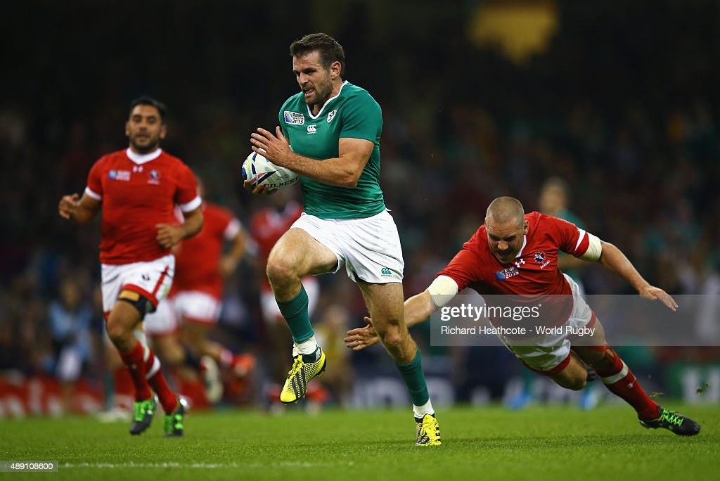 Jared Payne of Ireland breaks through the Canada defence to score a try during the 2015 Rugby World Cup Pool D match between Ireland and Canada at the Millennium Stadium on September 19, 2015 in Cardiff, United Kingdom.