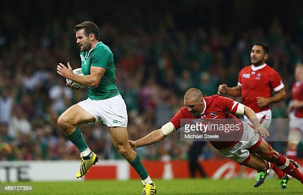 Jared Payne of Ireland breaks through to score a try during the 2015 Rugby World Cup Pool D match between Ireland and Canada at the Millennium...