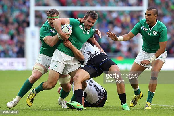Jared Payne of Ireland drives on during the 2015 Rugby World Cup Pool D match between Ireland and Romania at Wembley Stadium on September 27 2015 in...