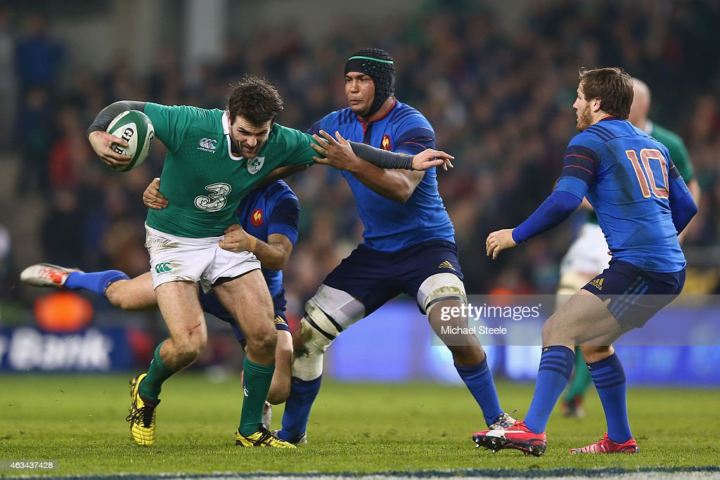 Jared Payne (L) of Ireland is held up by Morgan Parra (L) and Thierry Dusautoir (C) of France during the RBS Six Nations match between Ireland and France at the Aviva Stadium on February 14, 2015 in Dublin, Ireland.