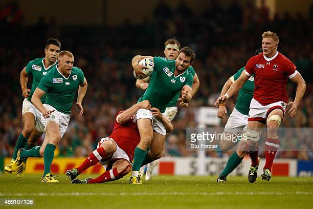 Jared Payne of Ireland looks to offload to Keith Earls of Ireland during the 2015 Rugby World Cup Pool D match between Ireland and Canada at the...