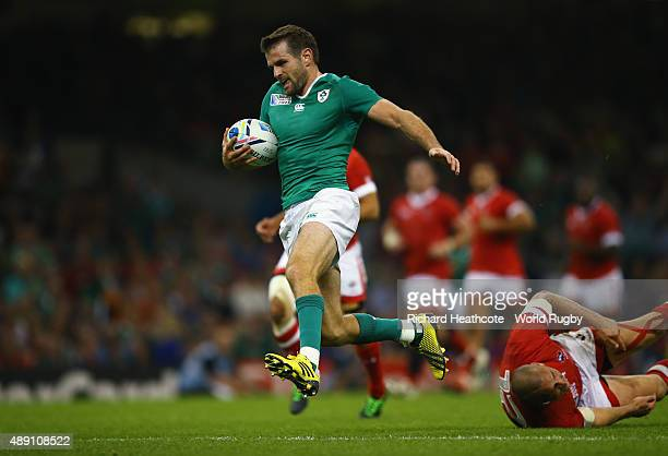 Jared Payne of Ireland runs in the score a try during the 2015 Rugby World Cup Pool D match between Ireland and Canada at the Millennium Stadium on...