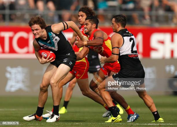 Jared Polec of the Power is tackled by Aaron Hall of the Suns during the 2017 AFL round 08 match between the Gold Coast Suns and Port Adelaide Power...