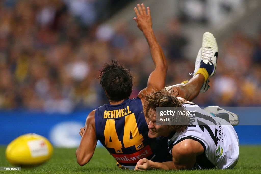 Jared Polec of the Power tackles Jamie Bennell of the Eagles during the round five AFL match between the West Coast Eagles and the Port Power at Patersons Stadium on April 19, 2014 in Perth, Australia.