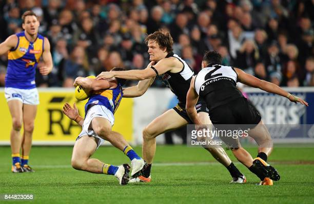 Jared Polec of the Power tackles Luke Shuey of the Eagles high during the AFL First Elimination Final match between Port Adelaide Power and West...
