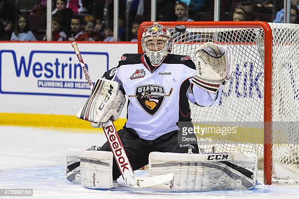 Jared Rathjen of the Vancouver Giants stops a shot from the Kelowna Rockets during a WHL game at the Pacific Coliseum on March 1 2014 in Vancouver...