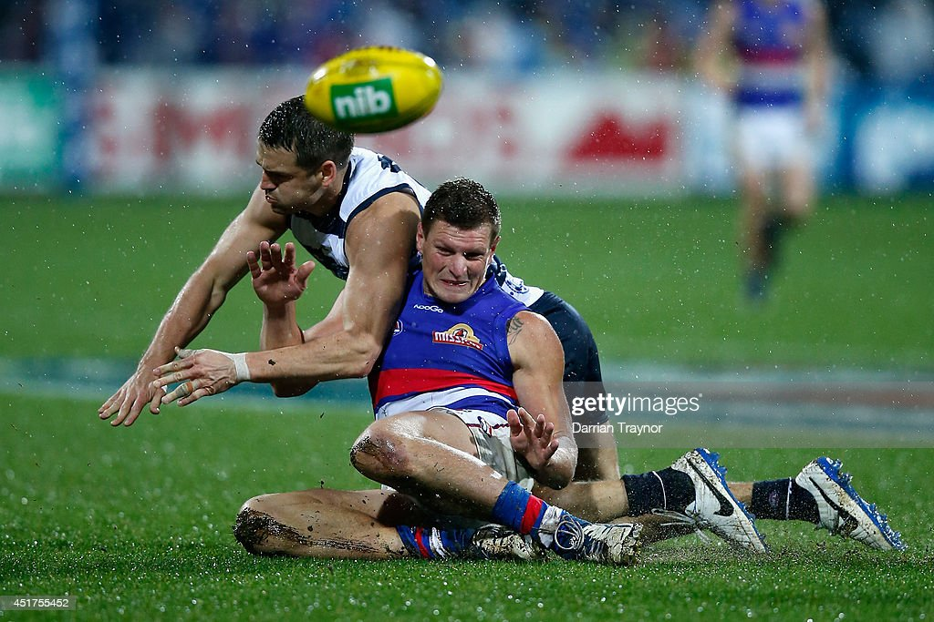 Jared Rivers of the Cats and Jack Redpath of the Bulldogs compete during the round 16 AFL match between the Geelong Cats and the Western Bulldogs at Skilled Stadium on July 6, 2014 in Melbourne, Australia.
