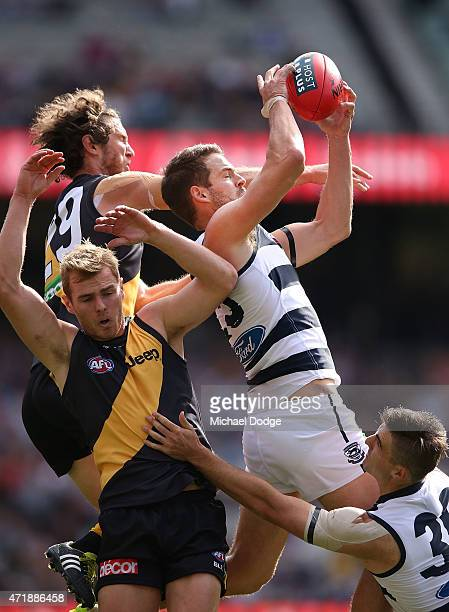 Jared Rivers of the Cats marks the ball against Tyrone Vickery of the Tigers during the round five AFL match between the Richmond Tigers and the...