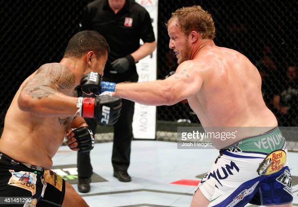 Jared Rosholt punches Soa Palelei in their heavyweight fight during the UFC Fight Night event at Vector Arena on June 28 2014 in Auckland New Zealand