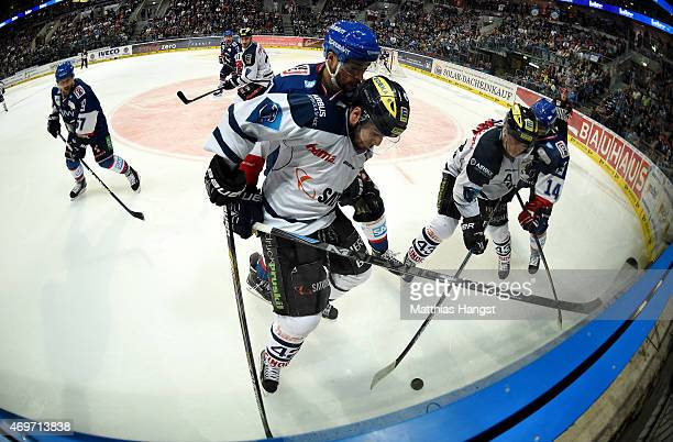 Jared Ross of Ingolstadt is challenged by Sinan Akdag of Mannheim during the DEL Playoffs Final Game 3 between Adler Mannheim and ERC Ingolstadt at...