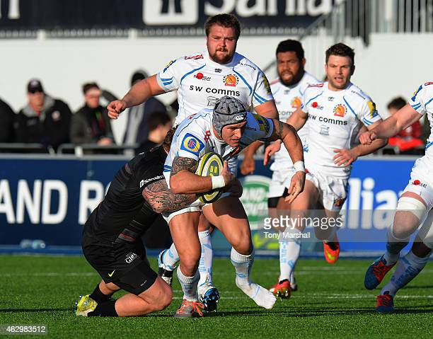 Jared Saunders of Saracens tackles Tom James of Exeter Chiefs during the LV= Cup match between Saracens and Exeter Chiefs at Allianz Park on February...