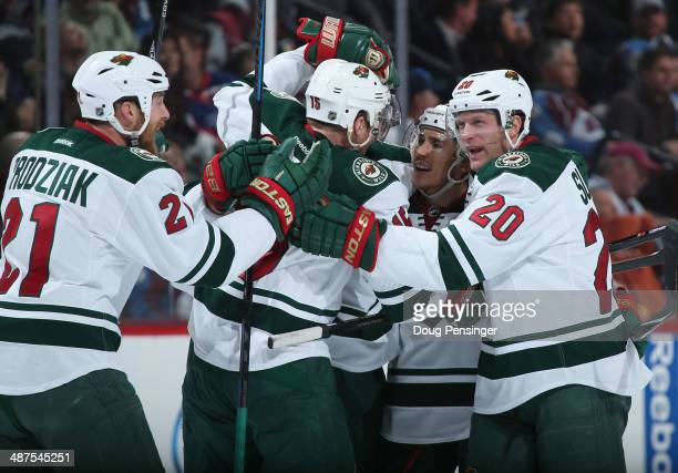 Jared Spurgeon of the Minnesota Wild celebrates his goal against the Colorado Avalanche with teammates Kyle Brodziak Dany Heatley and Ryan Suter of...