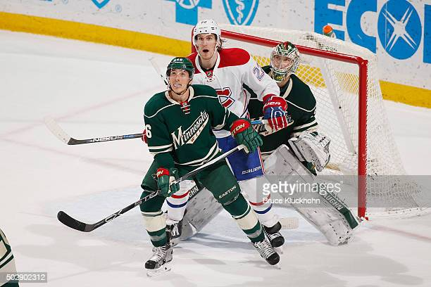 Jared Spurgeon and goalie Darcy Kuemper of the Minnesota Wild defend their goal against Dale Weise of the Montreal Canadiens during the game on...