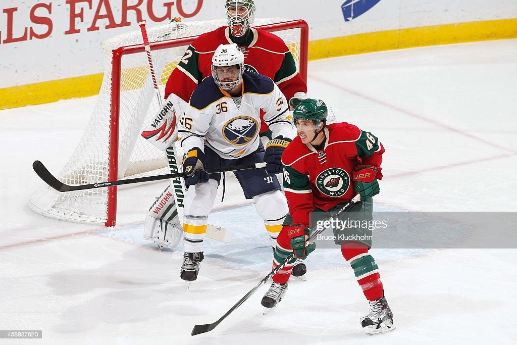 Jared Spurgeon and goalie Niklas Backstrom of the Minnesota Wild defend their goal against Patrick Kaleta of the Buffalo Sabres during the game on...