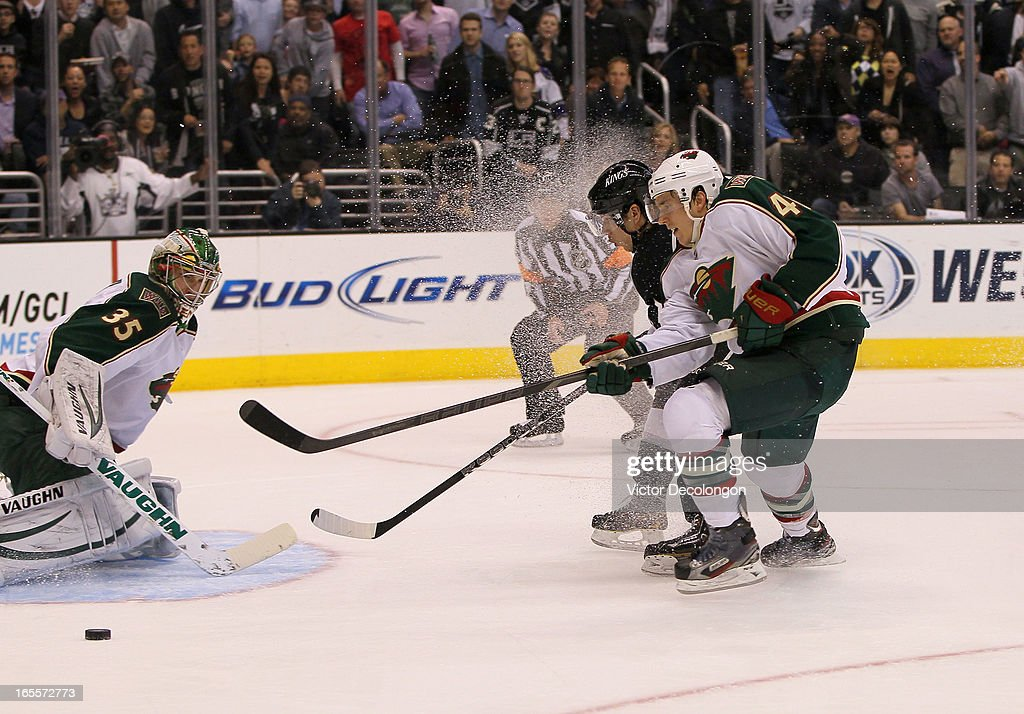 Jared Spurgeon #46 of the Minnesota Wild back checks on a breakaway by Jordan Nolan #71 of the Los Angeles Kingss as goaltender Darcy Kuemper #35 of the Minnesota Wild watches the puck slide by to his right during the second period of their NHL game at Staples Center on April 4, 2013 in Los Angeles, California. Spurgeon was called for a two-minute hooking penalty.