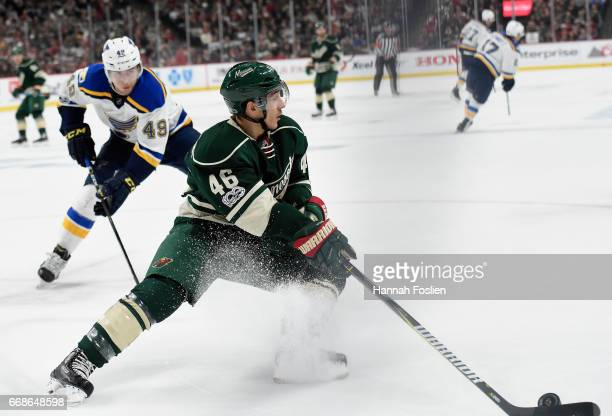 Jared Spurgeon of the Minnesota Wild controls the puck against Ivan Barbashev of the St Louis Blues during the first period in Game Two of the...