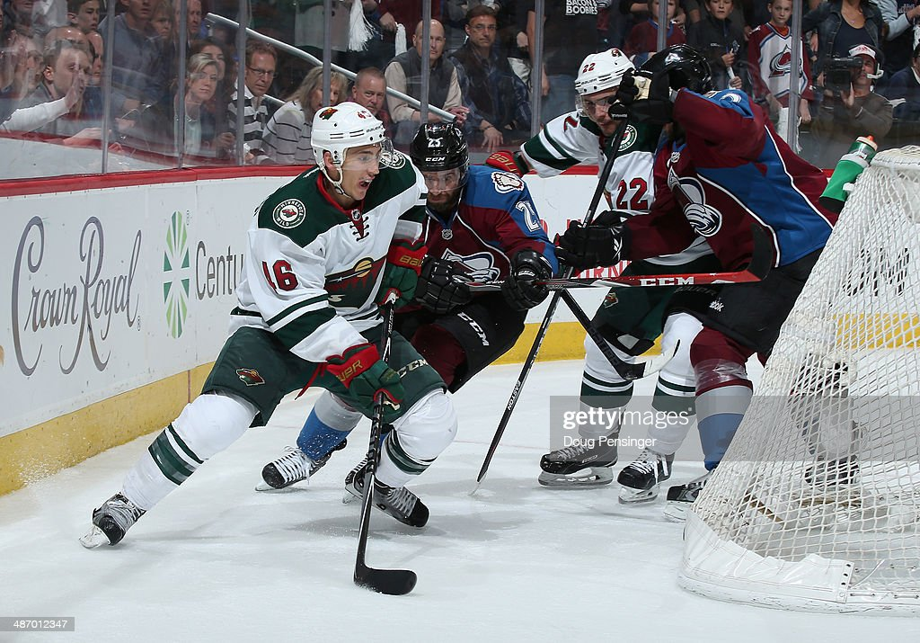 Jared Spurgeon #46 of the Minnesota Wild controls the puck against Maxime Talbot #25 of the Colorado Avalanche in Game Five of the First Round of the 2014 NHL Stanley Cup Playoffs at Pepsi Center on April 26, 2014 in Denver, Colorado. The Avalanche defeated the Wild 4-3 in overtime to take a 3-2 game lead in the series.