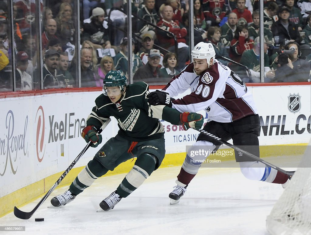 <a gi-track='captionPersonalityLinkClicked' href=/galleries/search?phrase=Jared+Spurgeon&family=editorial&specificpeople=4594192 ng-click='$event.stopPropagation()'>Jared Spurgeon</a> #46 of the Minnesota Wild controls the puck against <a gi-track='captionPersonalityLinkClicked' href=/galleries/search?phrase=Ryan+O%27Reilly&family=editorial&specificpeople=4754037 ng-click='$event.stopPropagation()'>Ryan O'Reilly</a> #90 of the Colorado Avalanche during the first period in Game Four of the First Round of the 2014 NHL Stanley Cup Playoffs on April 24, 2014 at Xcel Energy Center in St Paul, Minnesota. The Wild defeated the Avalanche 2-1.