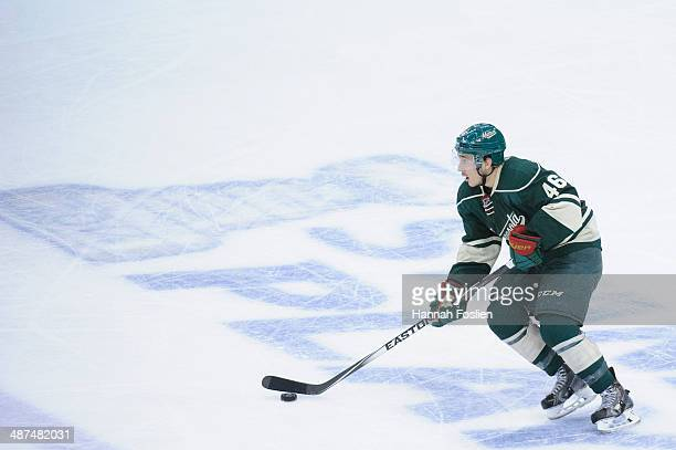 Jared Spurgeon of the Minnesota Wild controls the puck against the Colorado Avalanche in Game Six of the First Round of the 2014 NHL Stanley Cup...