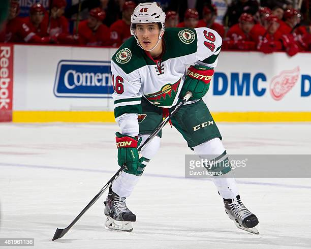 Jared Spurgeon of the Minnesota Wild gets set for the faceoff during a NHL game against the Detroit Red Wings on January 20 2015 at Joe Louis Arena...