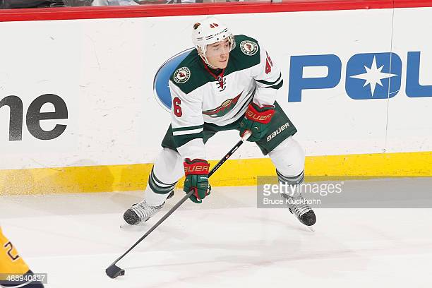 Jared Spurgeon of the Minnesota Wild handles the puck against the Nashville Predators during the game on February 6 2014 at the Xcel Energy Center in...