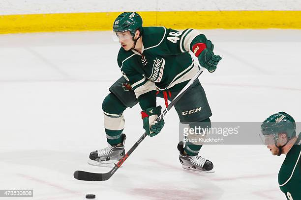 Jared Spurgeon of the Minnesota Wild handles the puck against the Chicago Blackhawks in Game Four of the Western Conference Semifinals during the...