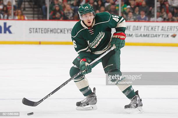 Jared Spurgeon of the Minnesota Wild handles the puck against the Colorado Avalanche during the game on December 5 2015 at the Xcel Energy Center in...
