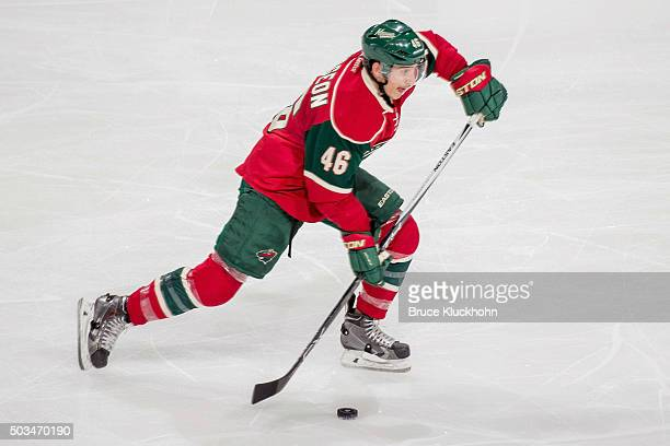 Jared Spurgeon of the Minnesota Wild handles the puck against the Pittsburgh Penguins during the game on December 26 2015 at the Xcel Energy Center...