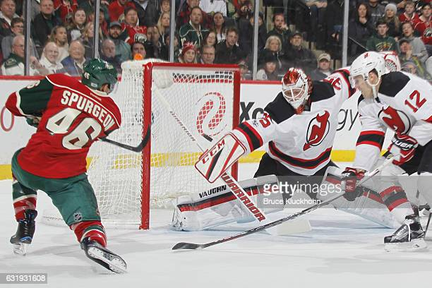 Jared Spurgeon of the Minnesota Wild scores a goal against Ben Lovejoy and goalie Cory Schneider of the New Jersey Devils during the game on January...