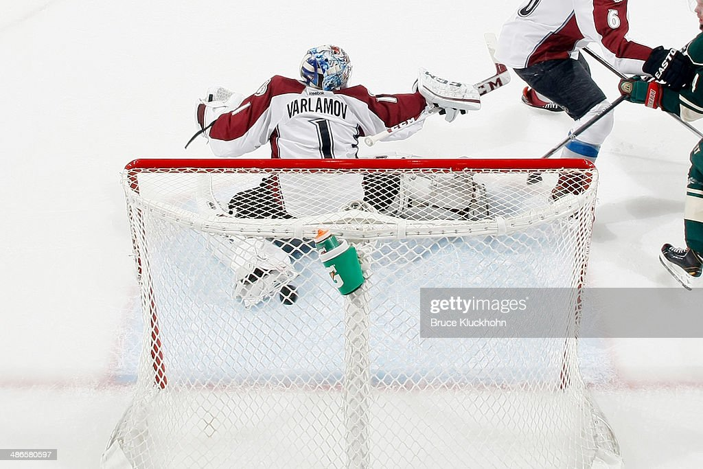 <a gi-track='captionPersonalityLinkClicked' href=/galleries/search?phrase=Jared+Spurgeon&family=editorial&specificpeople=4594192 ng-click='$event.stopPropagation()'>Jared Spurgeon</a> #46 of the Minnesota Wild scores a goal against <a gi-track='captionPersonalityLinkClicked' href=/galleries/search?phrase=Semyon+Varlamov&family=editorial&specificpeople=6264893 ng-click='$event.stopPropagation()'>Semyon Varlamov</a> #1 of the Colorado Avalanche during Game Four of the First Round of the 2014 Stanley Cup Playoffs on April 24, 2014 at the Xcel Energy Center in St. Paul, Minnesota.
