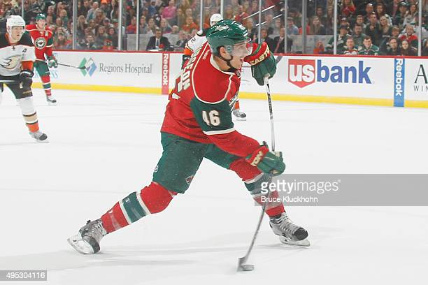 Jared Spurgeon of the Minnesota Wild shoots the puck against the Anaheim Ducks during the game on October 24 2015 at the Xcel Energy Center in St...