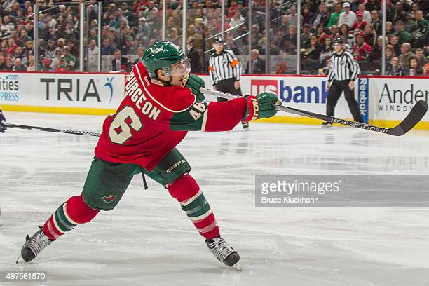 Jared Spurgeon of the Minnesota Wild shoots the puck against the Winnipeg Jets during the game on November 10 2015 at the Xcel Energy Center in St...
