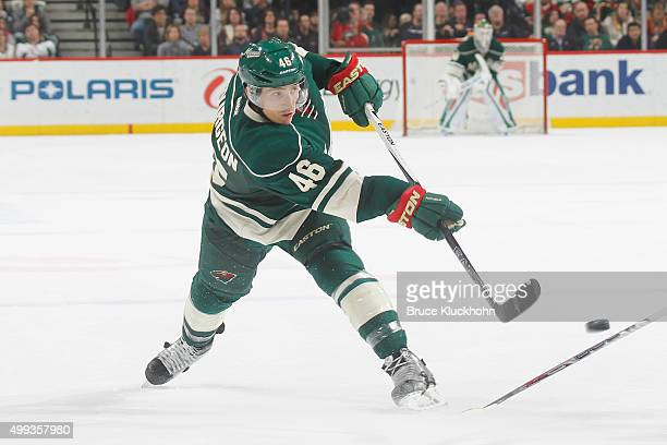Jared Spurgeon of the Minnesota Wild shoots the puck against the Vancouver Canucks during the game on November 25 2015 at the Xcel Energy Center in...