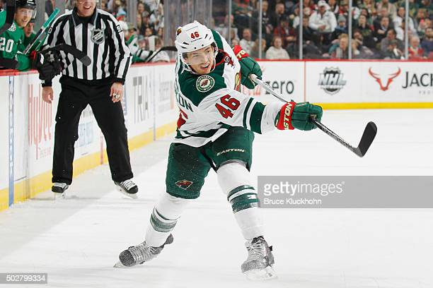 Jared Spurgeon of the Minnesota Wild shoots the puck against the Dallas Stars during the game on December 21 2015 at the Xcel Energy Center in St...