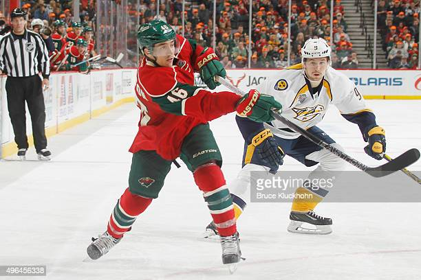 Jared Spurgeon of the Minnesota Wild shoots the puck with Filip Forsberg of the Nashville Predators defending during the game on November 5 2015 at...
