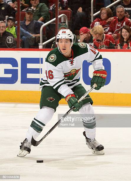 Jared Spurgeon of the Minnesota Wild skates with the puck against the Arizona Coyotes at Gila River Arena on December 11 2015 in Glendale Arizona