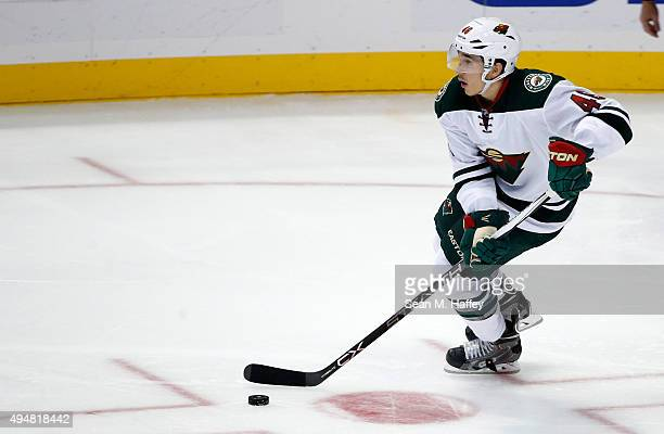 Jared Spurgeon of the Minnesota Wild skates with the puck during the third period of a game against the Anaheim Ducks at Honda Center on October 18...