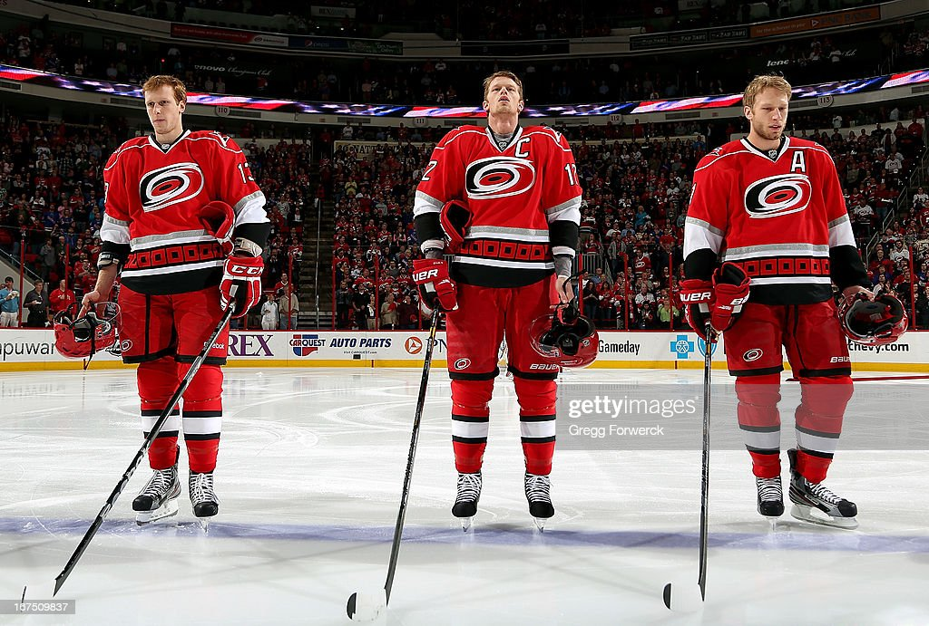 Jared Staal #13, Eric Staal #12 and Jordan Staal #11 of the Carolina Hurricanes are pictured during the National Anthem prior to an NHL game against the New York Rangers at PNC Arena on April 25, 2013 in Raleigh, North Carolina. Eric and Jordan Staal will be joined by 22-year-old brother Jared for the first time in a Hurricanes sweater as he makes his NHL debut tonight.