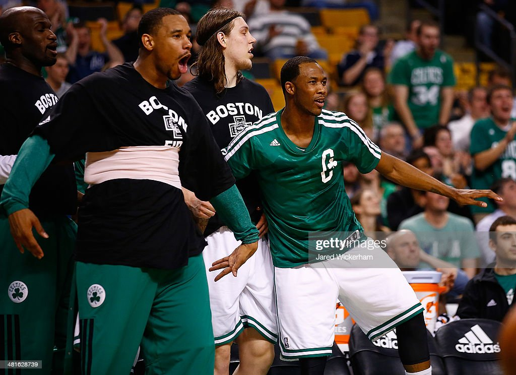 <a gi-track='captionPersonalityLinkClicked' href=/galleries/search?phrase=Jared+Sullinger&family=editorial&specificpeople=6866665 ng-click='$event.stopPropagation()'>Jared Sullinger</a> #7 and <a gi-track='captionPersonalityLinkClicked' href=/galleries/search?phrase=Chris+Babb&family=editorial&specificpeople=5758599 ng-click='$event.stopPropagation()'>Chris Babb</a> #52 of the Boston Celtics react to a dunk by teammate Brandon Bass #30 in the second quarter against the Chicago Bulls during the game at TD Garden on March 30, 2014 in Boston, Massachusetts.