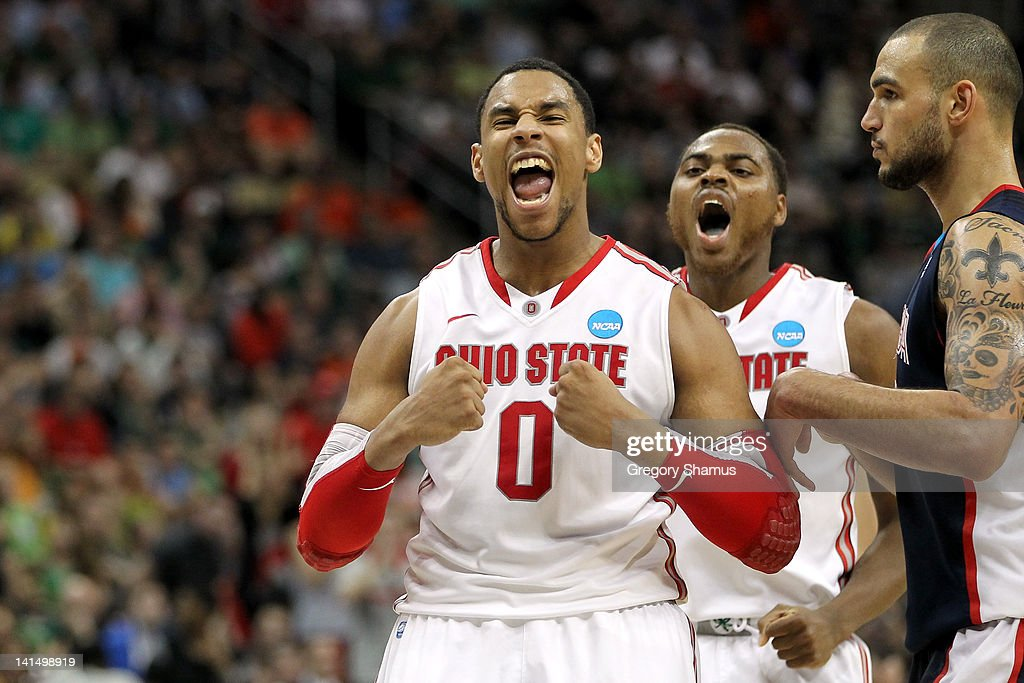 Jared Sullinger #0 and Deshaun Thomas #1 (C) of the Ohio State Buckeyes reacts in the second half against Robert Sacre #00 of the Gonzaga Bulldogs during the third round of the 2012 NCAA Men's Basketball Tournament at Consol Energy Center on March 17, 2012 in Pittsburgh, Pennsylvania.