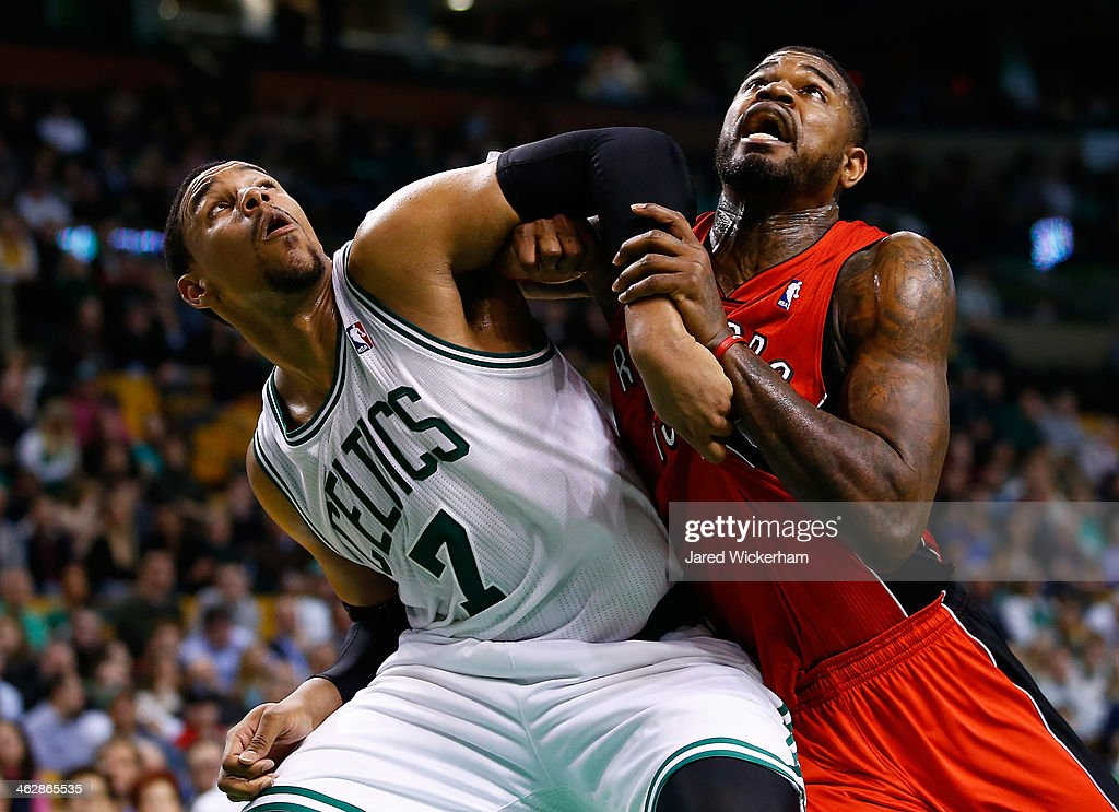 <a gi-track='captionPersonalityLinkClicked' href=/galleries/search?phrase=Jared+Sullinger&family=editorial&specificpeople=6866665 ng-click='$event.stopPropagation()'>Jared Sullinger</a> #7 of the Boston Celtics and <a gi-track='captionPersonalityLinkClicked' href=/galleries/search?phrase=Amir+Johnson&family=editorial&specificpeople=556786 ng-click='$event.stopPropagation()'>Amir Johnson</a> #15 of the Toronto Raptors battle for position underneath the basket in the second half during the game at TD Garden on January 15, 2014 in Boston, Massachusetts.