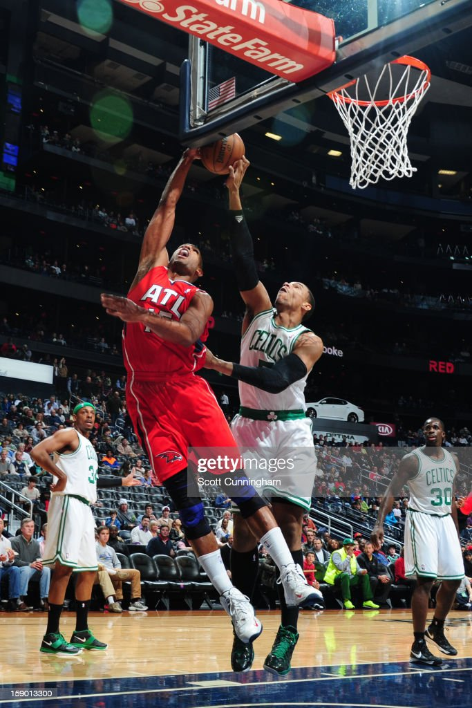 Jared Sullinger #7 of the Boston Celtics blocks a shot against Al Horford #15 of the Atlanta Hawks on January 5, 2013 at Philips Arena in Atlanta, Georgia.