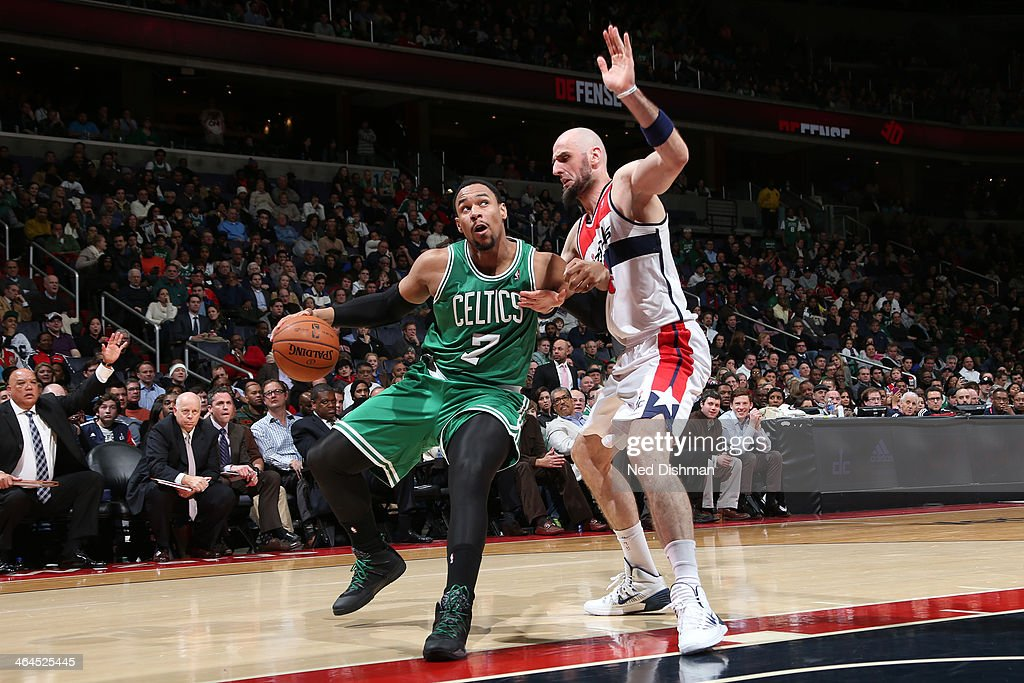 <a gi-track='captionPersonalityLinkClicked' href=/galleries/search?phrase=Jared+Sullinger&family=editorial&specificpeople=6866665 ng-click='$event.stopPropagation()'>Jared Sullinger</a> #7 of the Boston Celtics drives against <a gi-track='captionPersonalityLinkClicked' href=/galleries/search?phrase=Marcin+Gortat&family=editorial&specificpeople=589986 ng-click='$event.stopPropagation()'>Marcin Gortat</a> #4 of the Washington Wizards during the game at the Verizon Center on January 22, 2014 in Washington, DC.