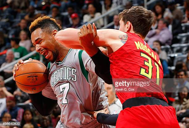 Jared Sullinger of the Boston Celtics drives against Mike Muscala of the Atlanta Hawks at Philips Arena on November 24 2015 in Atlanta Georgia NOTE...