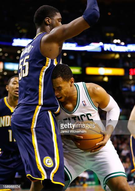 Jared Sullinger of the Boston Celtics drives to the basket in front of Roy Hibbert of the Indiana Pacers during the game on January 4 2013 at TD...