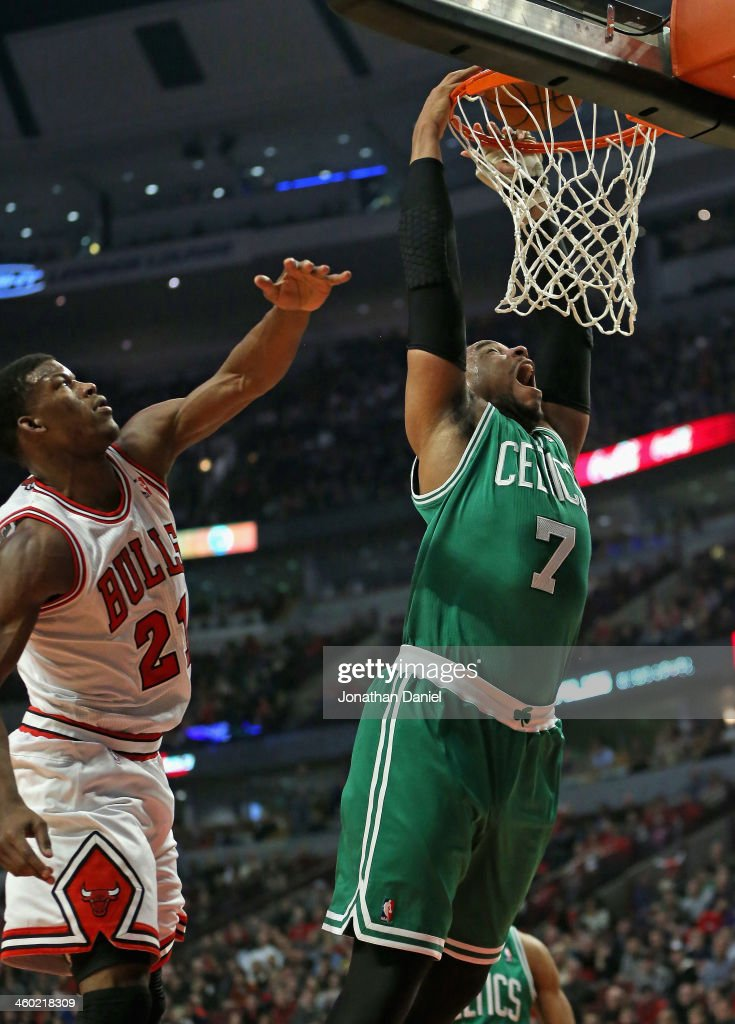 Jared Sullinger #7 of the Boston Celtics dunks past Jimmy Butler #21 of the Chicago Bulls at the United Center on January 2, 2014 in Chicago, Illinois.