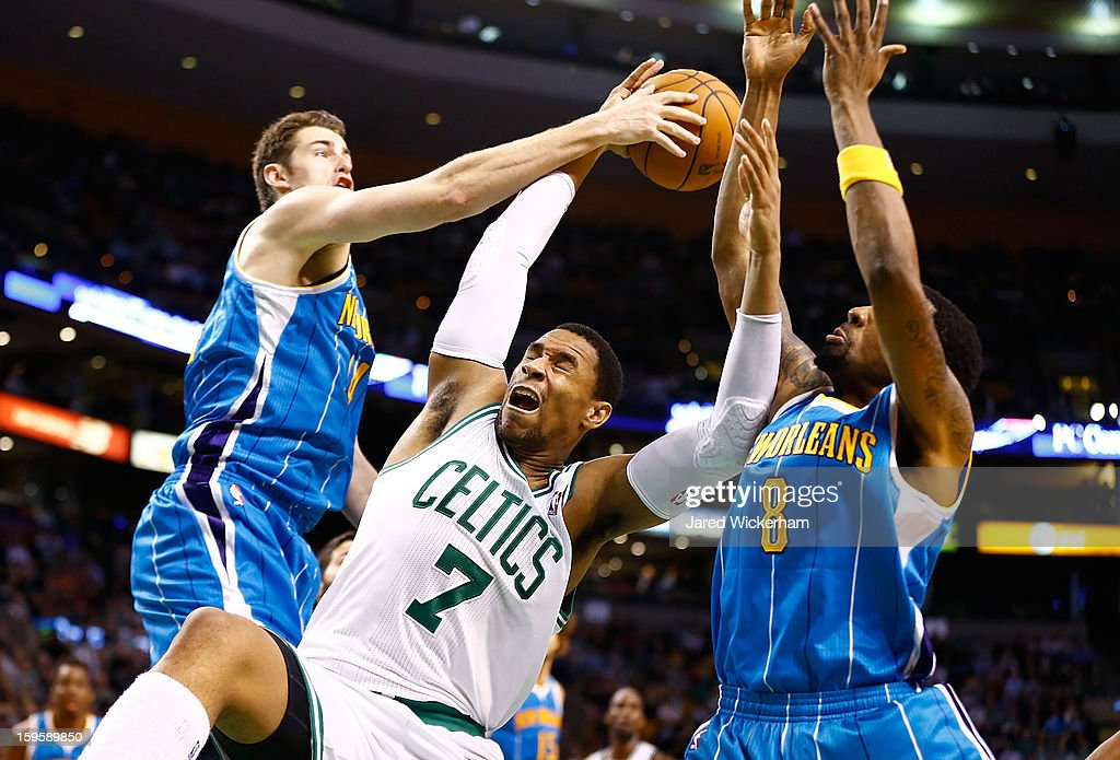 Jared Sullinger #7 of the Boston Celtics fights for a rebound between Jason Smith #14 and Roger Mason Jr. #8 of the New Orleans Hornets during the game on January 16, 2013 at TD Garden in Boston, Massachusetts.
