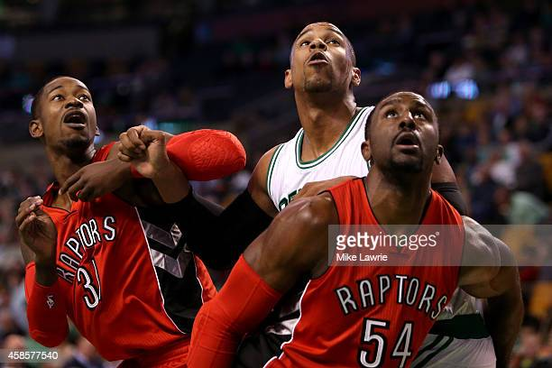 Jared Sullinger of the Boston Celtics fights for position with Terrence Ross and Patrick Patterson of the Toronto Raptors at TD Garden on November 5...