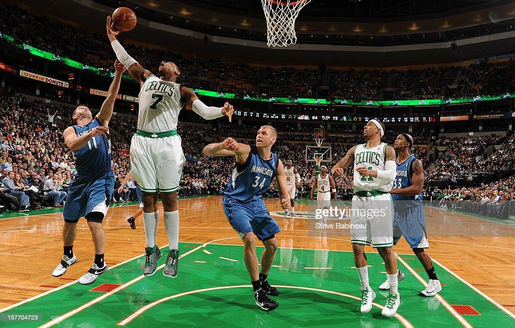 Jared Sullinger #7 of the Boston Celtics goes up for a rebound against Jose Juan Barea #11 of the Minnesota Timberwolves on December 5, 2012 at the TD Garden in Boston, Massachusetts.